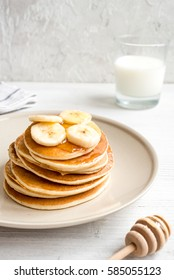 cooked pancake on plate at wooden background