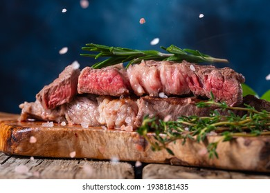 a cooked piece of beef, the steak is salted, the pieces of salt are frozen in motion. with vegetables