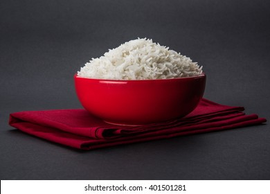 cooked plain white basmati rice in a ceramic bowl