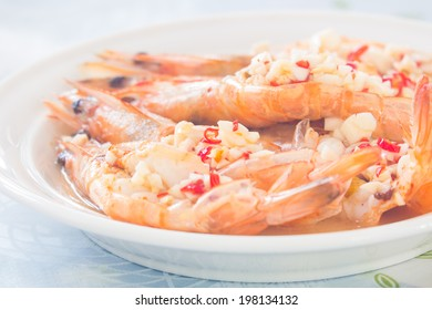 cooked prawn with the chopped chili and garlic on top