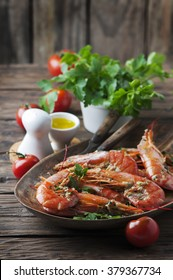 Cooked prawns with oil and parsley, selective focus