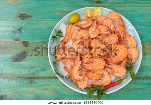 Cooked prawns on a green wooden background