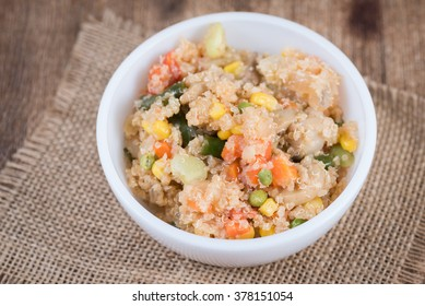 Cooked quinoa and vegetables in a white bowl.