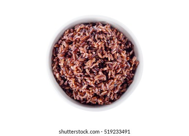 cooked red rice in white bowl on white background