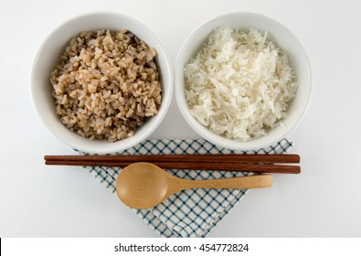 Cooked rice on white background at top view
