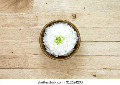 Cooked rice on wood table at top view