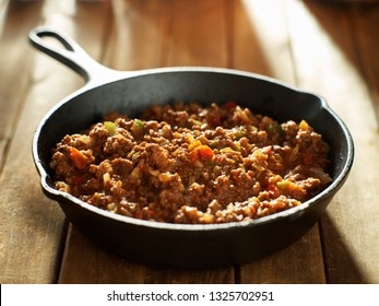 cooked sloppy joe mix in iron skillet made with ground beef