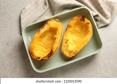 Cooked spaghetti squash in baking dish on table, top view