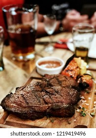cooked steak on a cutting board in a restaurant