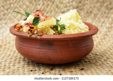 Cooked tapioca or Cassava root , Mandioca or Aipim, Kerala, India. Prepared with grated coconut to make South Indian food, Kappa Puzhukku, served with Fish curry, chutney. root vegetable Brazil.