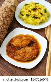 Cooked tapioca or Cassava root , Mandioca or Aipim with  spicy Fish curry, palm wine or toddy, Kerala, India. Prepared with grated coconut South Indian food, Kappa Puzhukku. vegetable Brazil.