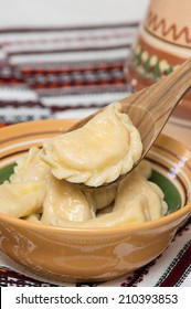 Cooked traditional Ukrainian hand-made varenyky (dumplings, pierogi ruskie in Poland) with cottage cheese in a bowl