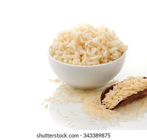 cooked and uncooked brown rice on white background