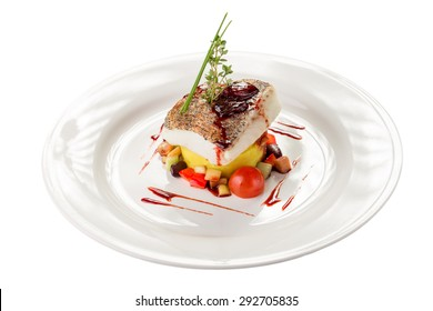 Cooked white fish fillet with colorful salad isolated on white background