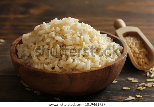Cooked Whole grain brown rice served in a bowl, selective focus