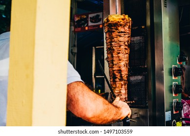 cooker is cutting meat for doner kebab in a Turkey fast dood restaurant