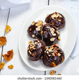Cookie balls with chocolate glaze and walnuts. Top view. Close up