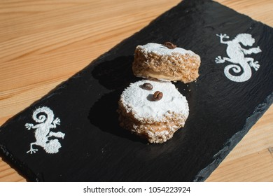 Cookie with caramelized milk dulce de leche and coconut, Argentine traditional cookies alfajores