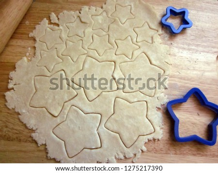 Cookie cutter stars cut into rolled-out pie crust