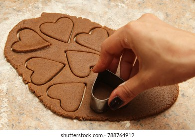 Cookie dough in the shape of hearts. This image can be used to represent baking for Valentines day.