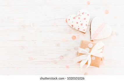cookie hearts and craft gift box on white rustic wooden background flat lay. happy mother's day greeting card. space for text . happy valentine's day or women's. mock-up