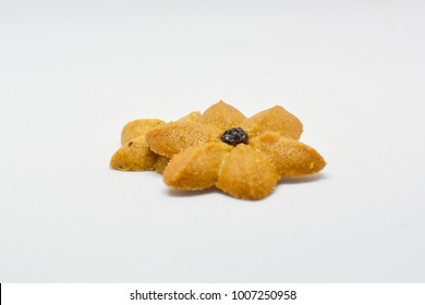The cookie like flower as coffee flavor top with a rasin on white background