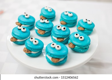 Cookie Monster macarons on white background
