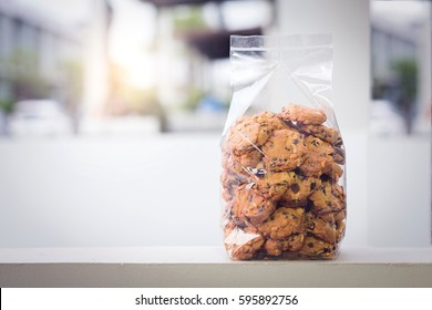 Cookie in plastic bag packaging with copy space.