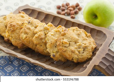 Cookies with apples, hazelnuts and cinnamon in a wooden bowl, horizontal