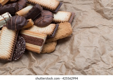 Cookies assorted on black background. Delicious morning snacks for breakfast, brunch and lunch. Appetizing, sweet and fast food