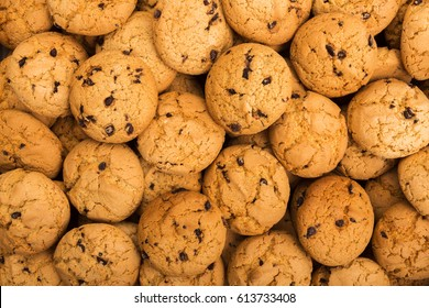 Cookies background. Chocolate chips biscuits texture background. Fattening sweets concept