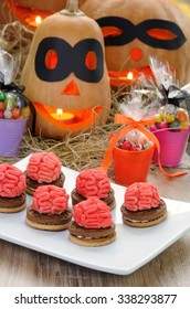Cookies with the brains of marzipan on a table in Halloween