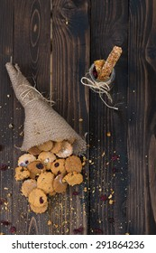 Cookies in the canvas bag on the rustic wooden table.