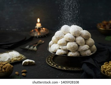 Cookies for celebration of El Fitr Islamic Feast( The Feast that comes after Ramadan).Sprinkling powdered sugar on Kahk (Eid-Al- Fitr cookies).