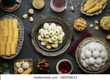Cookies for celebration of El -Fitr Islamic Feast.(The Feast that comes after Ramadan). Varities of Eid Al-Fitr sweets(Kahk,Gorayeba,Biscuits).Served with tea,dates fruits and roasted nuts.