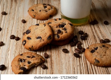 cookies with chocolate and milk on a light wooden table