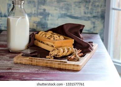 cookies with chocolate and milk on a wooden stand close-up.