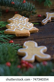 Cookies with Christmas motifs on rustic wood Bottom