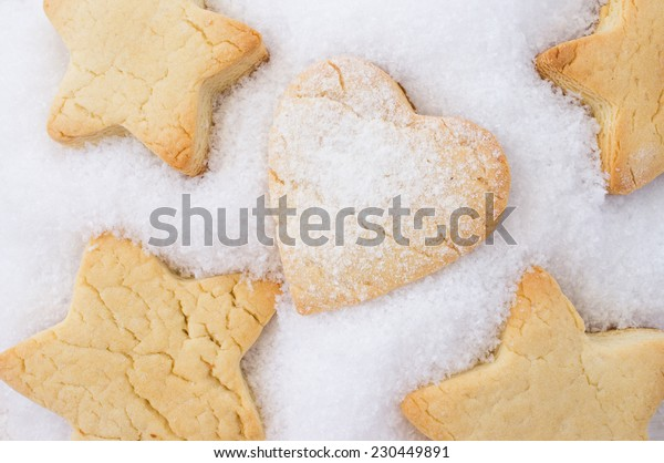 Cookies for Christmas, New Year. In the form of stars in snow