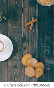 Cookies and coffee on the wooden table.