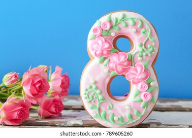 cookies covered with glaze made in a form of number eight.ginger biscuits for March 8.International Women's Day