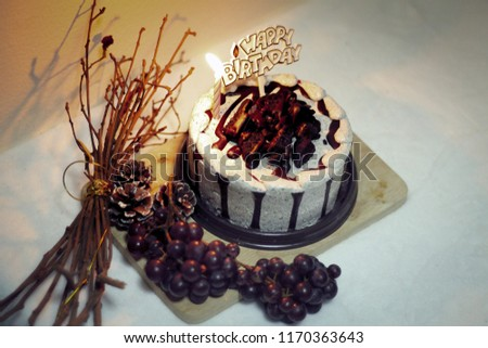 Cookies And Cream Birthday Cake With A Little Candle Light