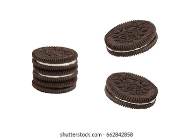 Cookies and cream chocolate cookies stack and single pieces isolated on white background (clipping path included)