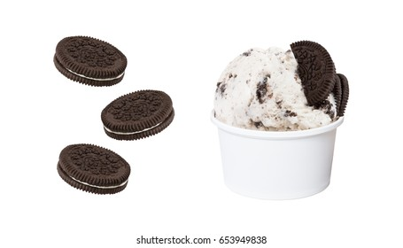 Cookies and cream ice cream scoop in white cup and pieces of cookie isolated on white background (clipping path included), close-up shot