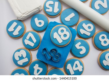 cookies decorated with numbers. Blue sugar paste. Celebration. Turn years. Snack.