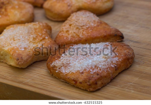Cookies of different shapes with sugar for a Golden crust.