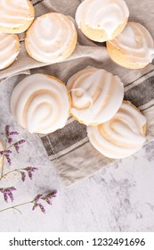 Cookies with egg white cover. Portuguese sweets known as cavacas on napkin in a table.