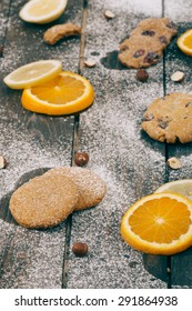 Cookies and fruits on the wooden table. Selective focus and small depth of field.