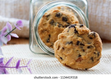 Cookies in glass jar on wood table.