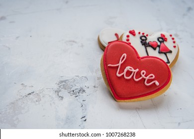 Cookies hearts with white and red icing Love for Valentine's Day.